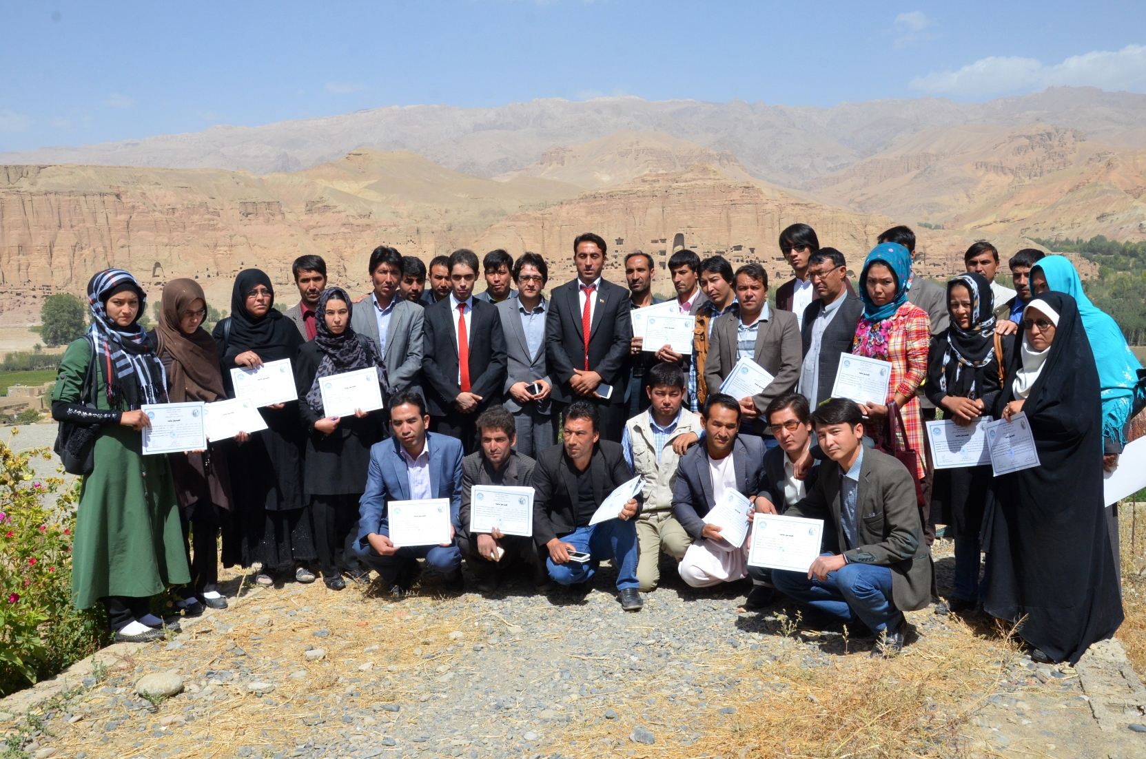 Hamidullah Arefi, secretary South Asia Foundation-Afghanistan distributing certificates on cultural heritage in Bamyan