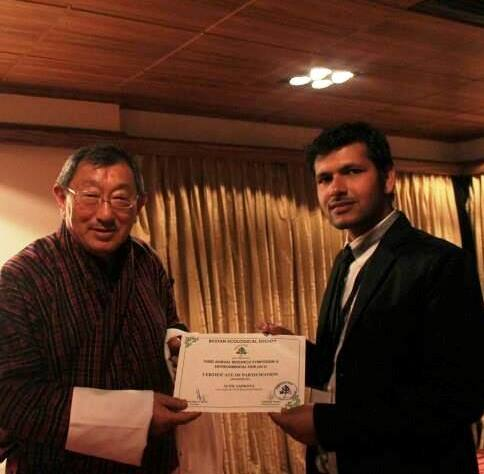 Presentation by Mr Sunil, Madanjeet Singh Group Scholarship of South Asia Foundation  UMCSAFS, recieving certiicate from President of Bhutan