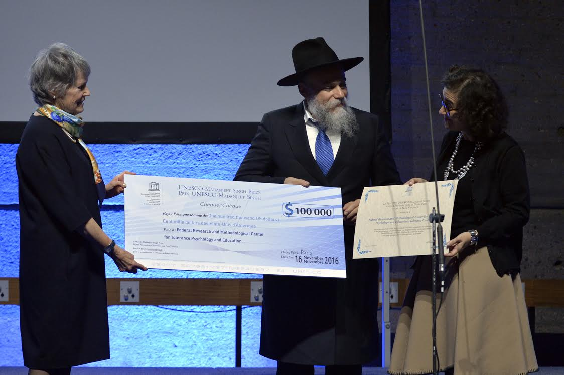 Mme. France Marquet heanding over prize of $ 100,000 to Alexander Boroda and Nada Al-Nashi UNESCO Madanjeet Singh Prize -compiled by Sunil Binjola