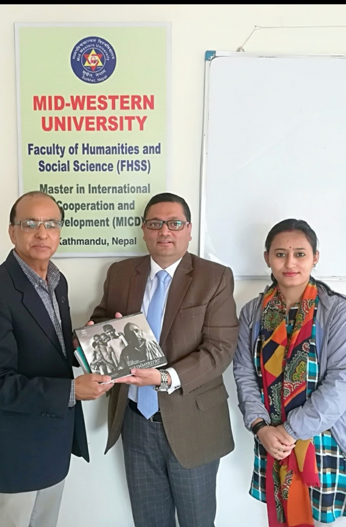 SAF-Nepal Chairperson Dr. Nishchal N. Pandey handed over the 'Kashmiriyat' to the faculty of the Mid-western university, Kathmandu
